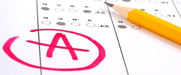 Meer aandacht voor schoolexamens